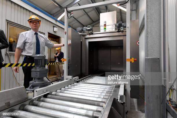 Georg Bacmeister Head of the Disposal Division standing at a freestanding system for material that leads to the outside of the Brunsbuttel nuclear...