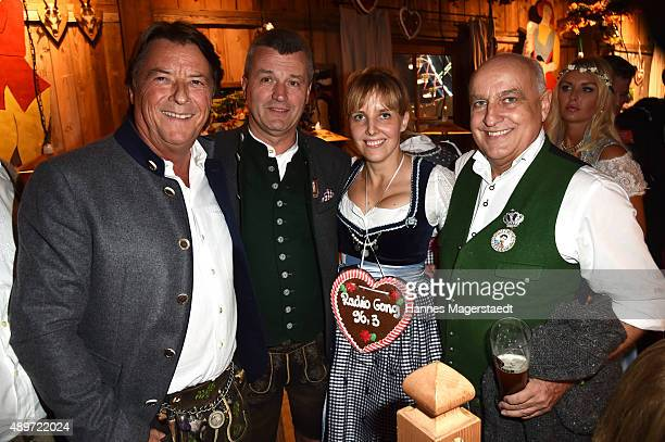 Georg Dingler Wolfgang Wenger Nina Munz and Axel Munz attend the Radio Gong 963 Wiesn at Weinzelt during the Oktoberfest 2015 on September 23 2015 in...