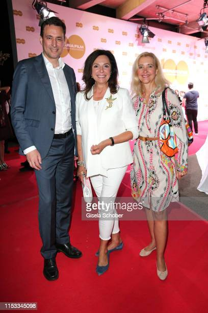 Georg Eisenreich Uschi Daemmrich von Luttitz and Claudia Cieslarzcyk editor in chief of Frau im Spiegel during the Bavaria Film Reception One Hundred...