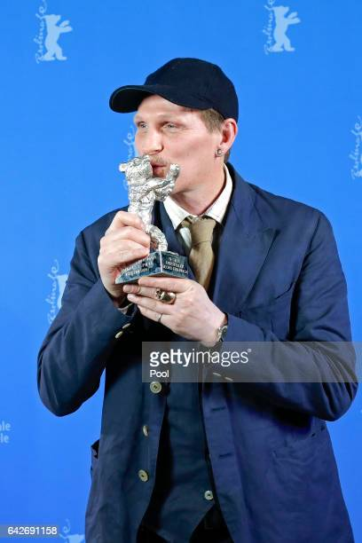 Georg FriedricActor h kisses his Silver Bear for Best Actor in Bright Nights backstage after the closing ceremony of the 67th Berlinale International...