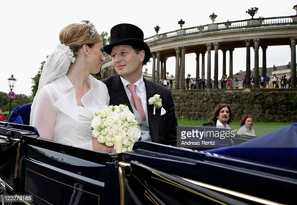 Georg Friedrich Ferdinand Prince of Prussia and Princess Sophie of Prussia smile during their ride in a historical carriage after the religious...