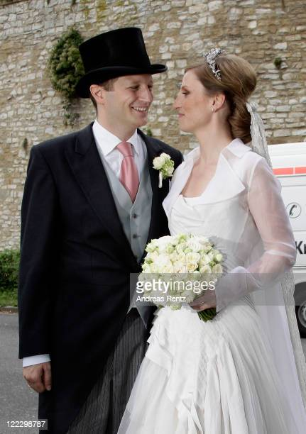 Georg Friedrich Ferdinand Prince of Prussia smiles to his wife Princess Sophie of Prussia as they leave their religious wedding ceremony in the...