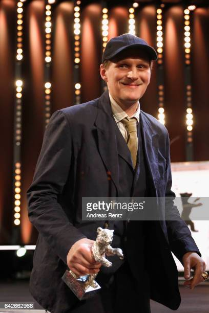 Georg Friedrich holding his Silver Bear for Best Actor in the film Bright Nights at the closing ceremony of the 67th Berlinale International Film...