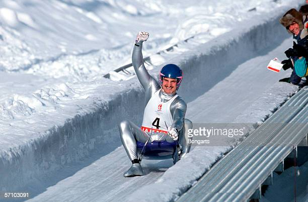Georg Hackl of Germany celebrates after winning the gold medal during the luge competition during the Olympic Games on February 10 1992 in...