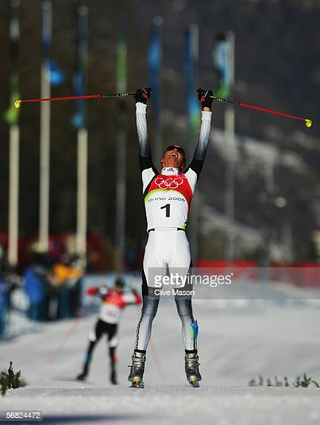 Georg Hettich of Germany celebrates winning Gold Medal after victory in the Nordic Combined 15km Individual event on Day 1 of the 2006 Turin Winter...