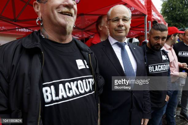 Georg Kippels Christian Democrat Union lawmaker center poses for a photograph with RWE AG workers during a town center demonstration in Bergheim...