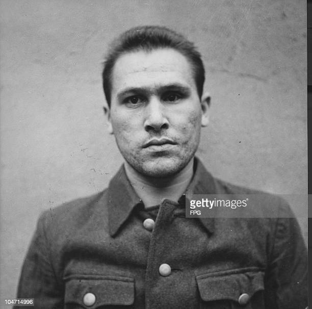 Georg Kraft, a guard at the Bergen-Belsen concentration camp, Germany, circa 1945. Charged with war crimes and crimes against humanity, Kraft is...
