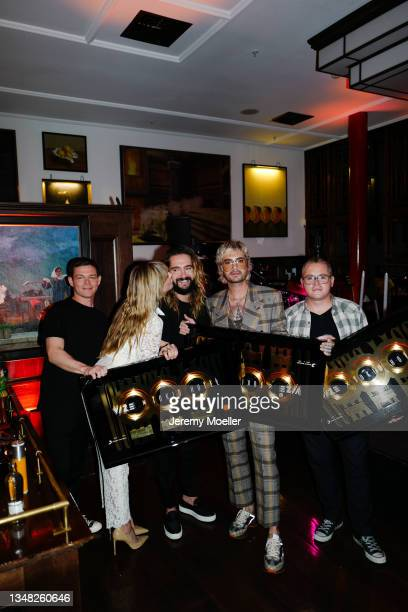 Georg Listing, Heidi Klum, Tom Kaulitz, Bill Kaulitz and Gustav Schäfer seen backstage during the Tokio Hotel New Album Release Party on October 22,...