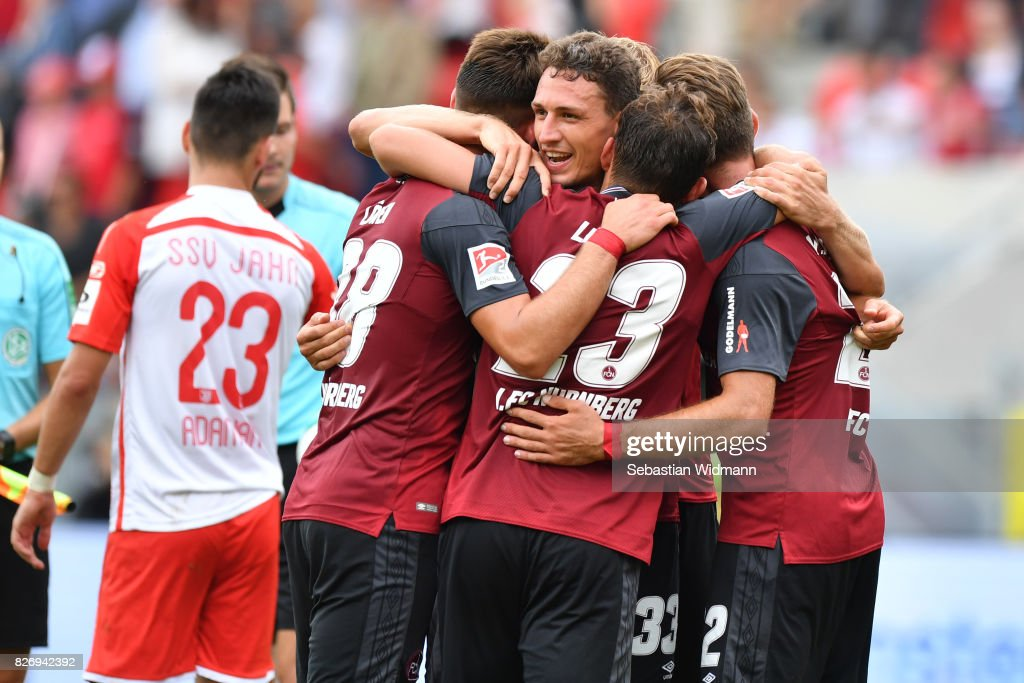 Georg Margreitter of 1. FC Nuernberg celebrates with teammates after the Second Bundesliga match between SSV Jahn Regensburg and 1. FC Nuernberg at Continental Arena on August 6, 2017 in Regensburg, Germany.