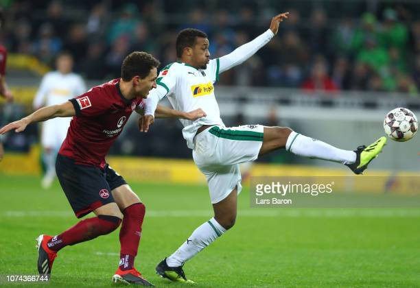 Georg Margreitter of Nuernberg and Alassane Plea of Borussia Monchengladbach during the Bundesliga match between Borussia Moenchengladbach and 1 FC...