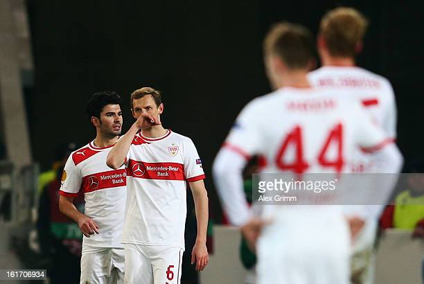 Georg Niedermeier and Serdar Tasci of Stuttgart react during the UEFA Europa League Round of 32 first leg match between VfB Stuttgart and KRC Genk at...