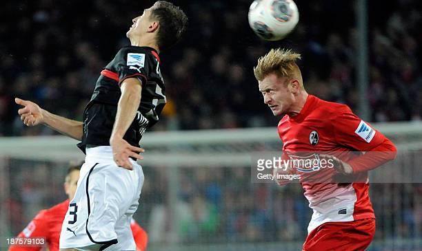 Georg Niedermeier of Stuttgart and Sebastian Kerk of Freiburg jumping for a header during the Bundesliga match between SC Freiburg and VfB Stuttgart...