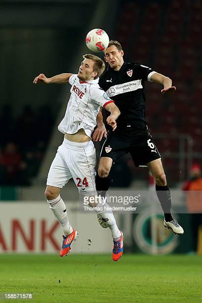 Georg Niedermeier of Stuttgart battles for the ball with Kacper Prybylko of Koeln during the DFB cup round of sixteen match between VfB Stuttgart and...