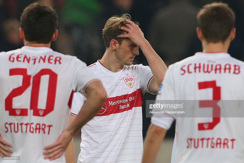 Georg Niedermeier (C) of Stuttgart reacts with his team mates Christian Gentner (L) and Daniel Schwaab after the Bundesliga match between VfB Stuttgart and Borussia Moenchengladbach at Mercedes-Benz Arena on November 22, 2013 in Stuttgart, Germany.