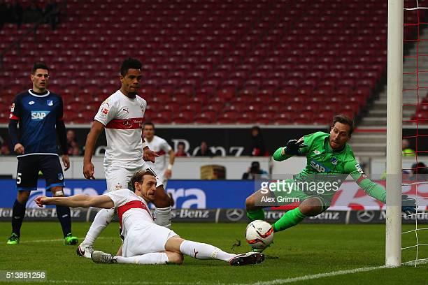 Georg Niedermeier of Stuttgart scores his team's first goal against goalkeeper Oliver Baumann of Hoffenheim during the Bundesliga match between VfB...