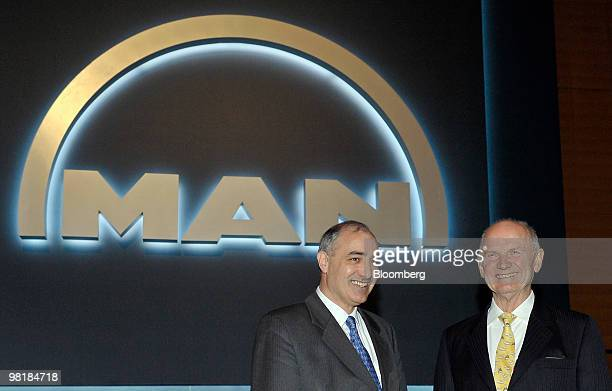 Georg Pachta Reyhofen, chief executive officer of MAN SE, left, and Ferdinand Piech, chairman of the company's supervisory board, pose prior to the...