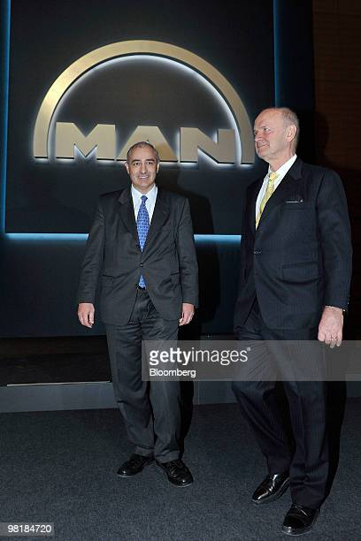 Georg Pachta Reyhofen, chief executive officer of MAN SE, left, and Ferdinand Piech, chairman of the company's supervisory board, arrive for the...
