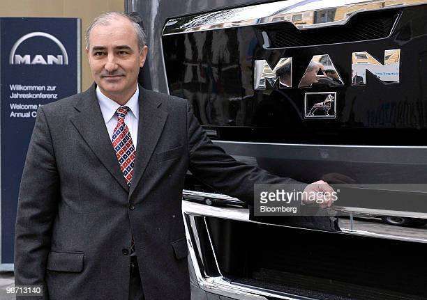 Georg Pachta Reyhofen chief executive officer of MAN SE poses with a MAN TGX 18680 4x2 BLS truck prior to the company's news conference in Munich...