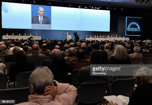 Georg Pachta Reyhofen, chief executive officer of MAN SE, speaks on a large screen at the company's annual shareholders' meeting in Munich, Germany,...