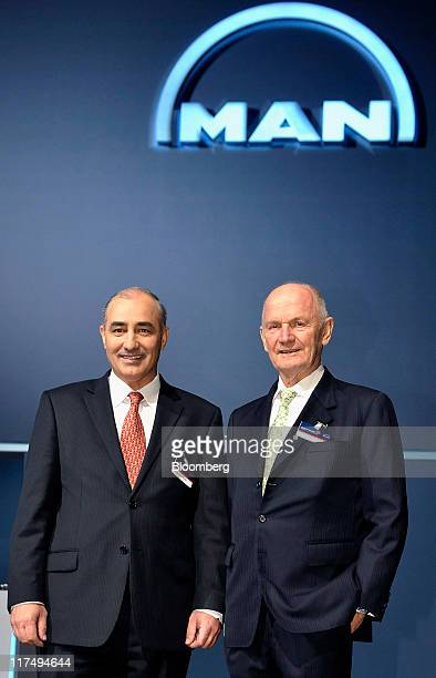 Georg PachtaReyhofen chief executive officer of MAN SE left and Ferdinand Piech chairman of the supervisory board of MAN SE pose for a photograph...