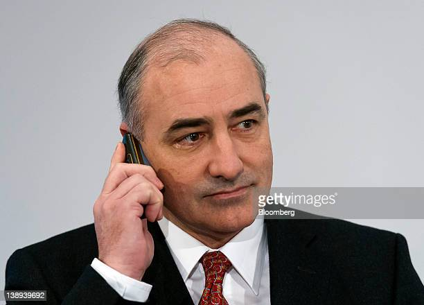 Georg PachtaReyhofen chief executive officer of MAN SE uses his mobile telephone during a news conference in Munich Germany on Tuesday Feb 14 2012...