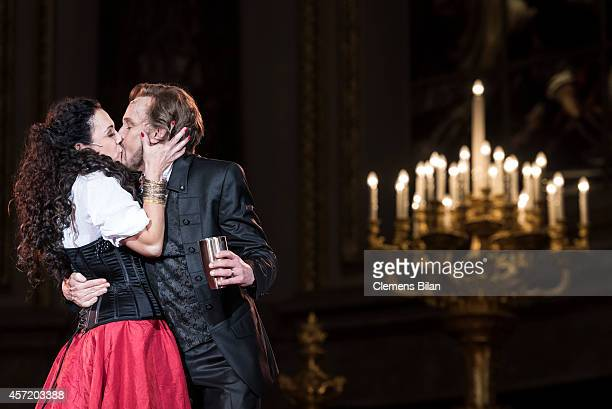 Georg Preusse and Barbara Wussow perform on stage during rehearsals for 'Berliner Jedermann' at Berliner Dom on October 14 2014 in Berlin Germany
