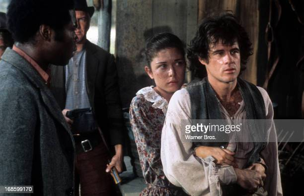 Georg Stanford Brown watches as Lane Binkley holds onto Brad Davis in a scene from the Television Series 'Roots' 1977