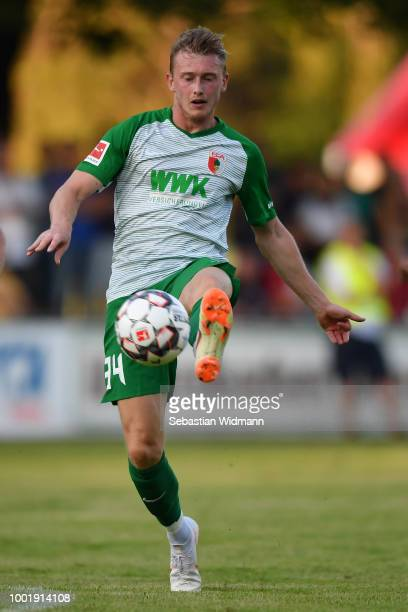 Georg Teigl of Augsburg plays the ball during the preseason friendly match between SC Olching and FC Augsburg on July 19 2018 in Olching Germany