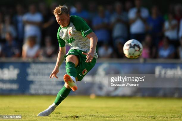 Georg Teigl of Augsburg scores the first goal for his team with a free kick during the preseason friendly match between SC Olching and FC Augsburg on...