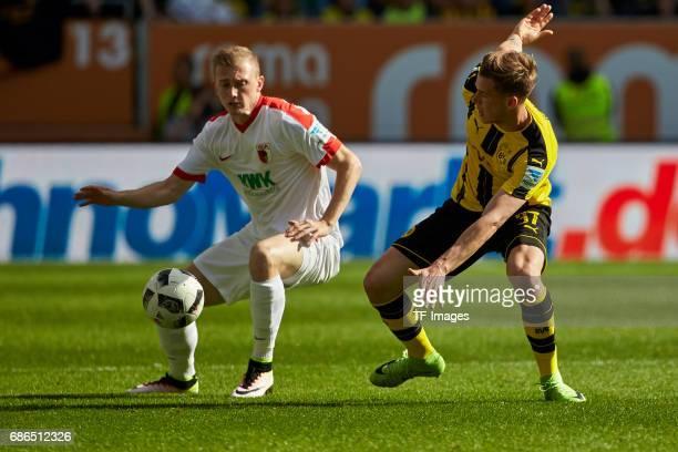 Georg Teigl of Augsburg und Erik Durm of Dortmund battle for the ball during the Bundesliga match between FC Augsburg and Borussia Dortmund at the...