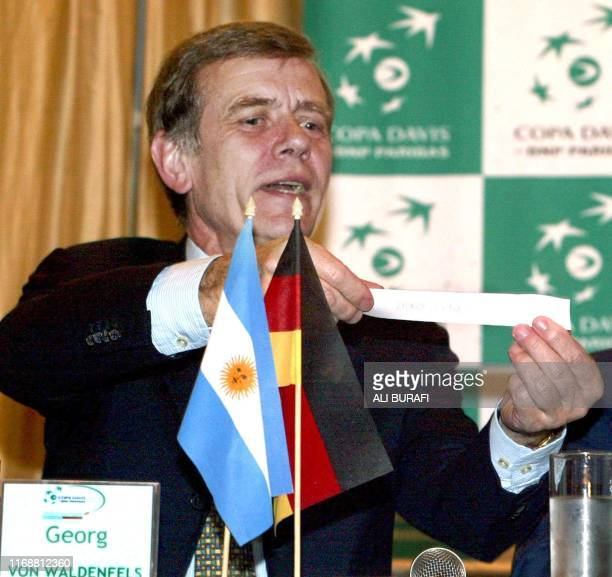 Georg Von Waldenfels president of the German tennis federation draws the order of play for the first round of the World Group match of the Davis Cup...