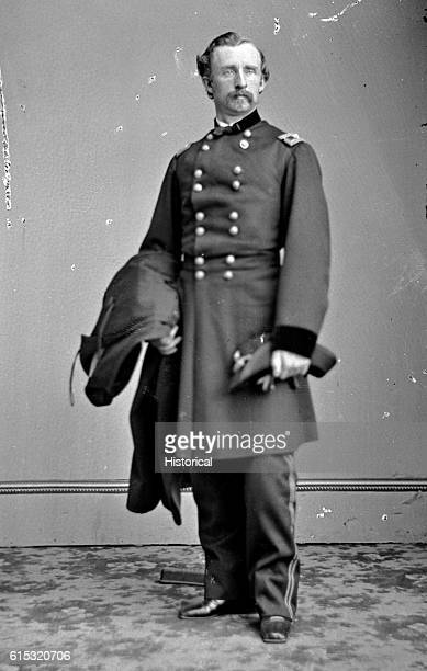 George A Custer in a brigadier general uniform June 29 1863Oct 19 1864 Standing full length full face holding hat in left hand cape or coat in right...