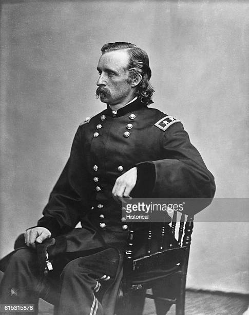 George A Custer in a major general uniform some time after October 19 1864 Seated threequarter length left profile left hand on arm of chair mustache...