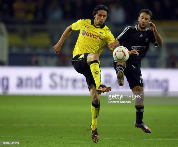 George Adamia of Qarabag challenges Neven Subotic of Dortmund during the UEFA Europa League Play-Off match between Borussia Dortmund and Qarabag at...