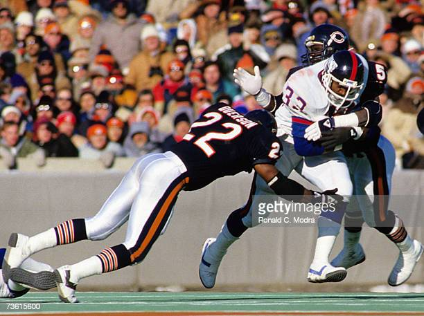 George Adams of the New York Giants carries the ball in the NFC Divisional Playoff Game against the Chicago Bears on January 5 1986 in Chicago...