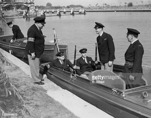 George Allison , manager of Arsenal Football Club joins a flotilla of river cruisers and motorboats of the LDV Home Guard river patrol on 18th August...