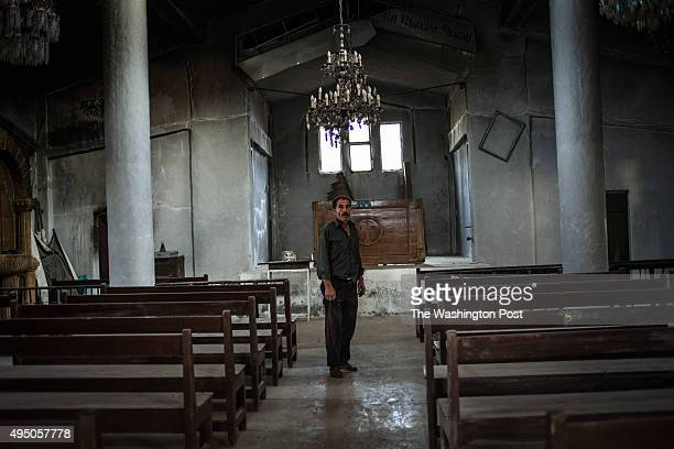 George an Armenian Christian stands inside the church he claims was used by Islamic State militants as a prison and school where they allegedly...