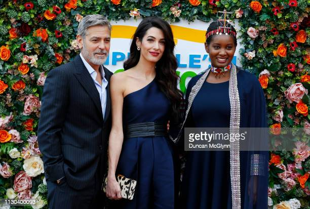 George and Amal Clooney and human rights activist Nice Nailantei Leng'ete attend the People's Postcode Lottery Charity Gala at McEwan Hall on March...