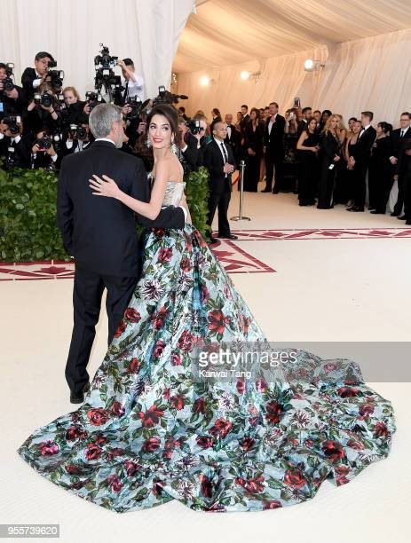 George and Amal Clooney attend 'Heavenly Bodies Fashion The Catholic Imagination' Costume Institute Gala at the Metropolitan Museum of Art on May 7...