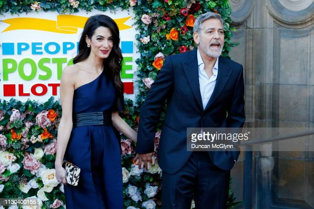 George and Amal Clooney attend the People's Postcode Lottery Charity Gala at McEwan Hall on March 14 2019 in Edinburgh Scotland The couple will be...
