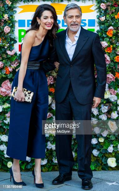 George and Amal Clooney attend the People's Postcode Lottery Charity Gala at McEwan Hall on March 15 2019 in Edinburgh Scotland The couple will be...