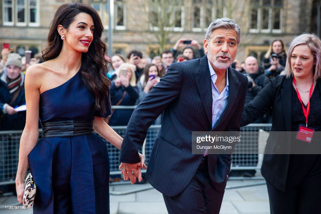George And Amal Clooney in Edinburgh To Receive Charity Award : News Photo