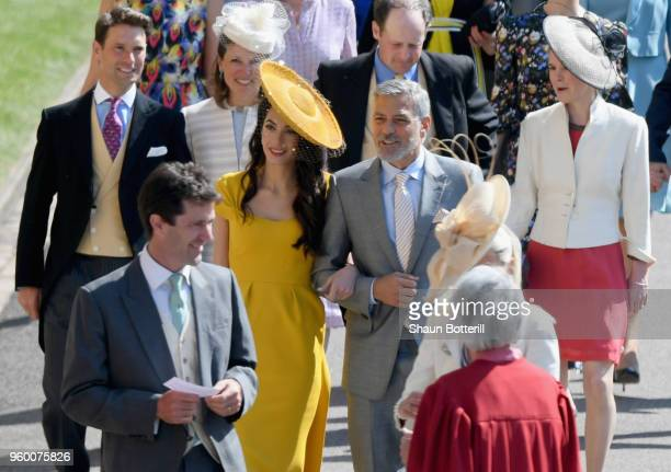 George and Amal Clooney attend the wedding of Prince Harry to Ms Meghan Markle at St George's Chapel Windsor Castle on May 19 2018 in Windsor England...
