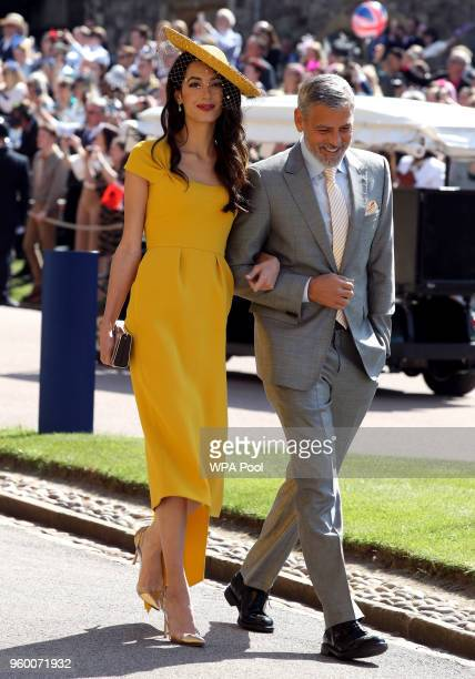 George and Amal Clooney leave St George's Chapel at Windsor Castle after the wedding of Prince Harry to Meghan Markle on May 19 2018 in Windsor...