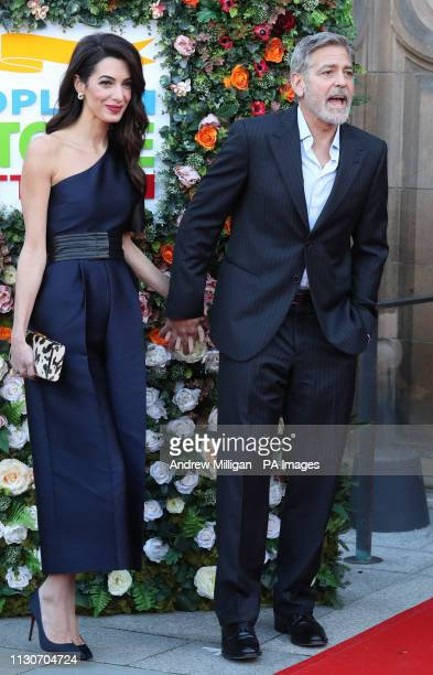 George and Amal Clooney representing the Clooney Foundation for Justice arrive at the People's Postcode Lottery charity gala at the McEwan Hall in...