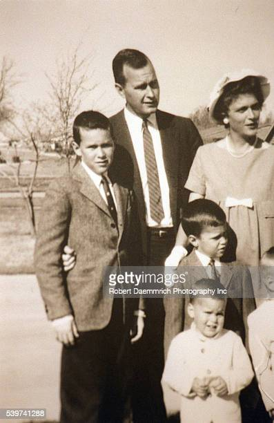George and Barbara Bush with their four boys George W Neil Jeb and Marvin