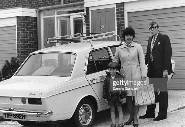 George and Brenda Spragg with their son Michael in the driveway of their home by their Hillman Hunter car