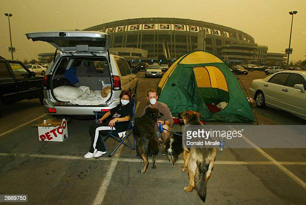 George and Maria Little of Alpine find a place to rest with their dogs at the evacuation center at Qualcomm Stadium October 27 2003 in San Diego...