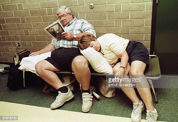 George Anderson and his wife Rita from Myrtle Beach South Carolina rest at a hurricane shelter set up at Conway High School in Conway 35 miles inland...