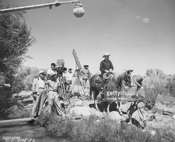 George Archainbaud directs actors Gene Autry and Neyle Morrow in a scene for the Columbia Pictures movie 'Goldtown Ghost Riders', on location near...